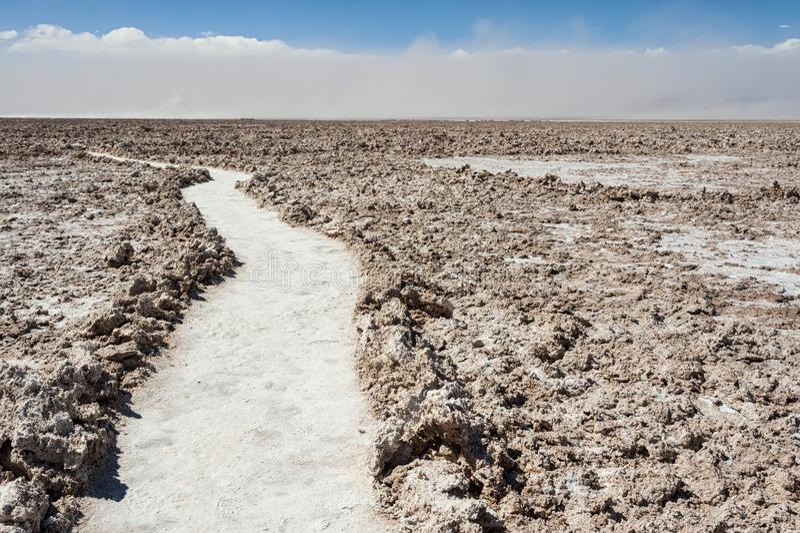 Road at Salar de Atacama, the largest salt flat in Chile Desert of the Atacama, Chile royalty free stock image