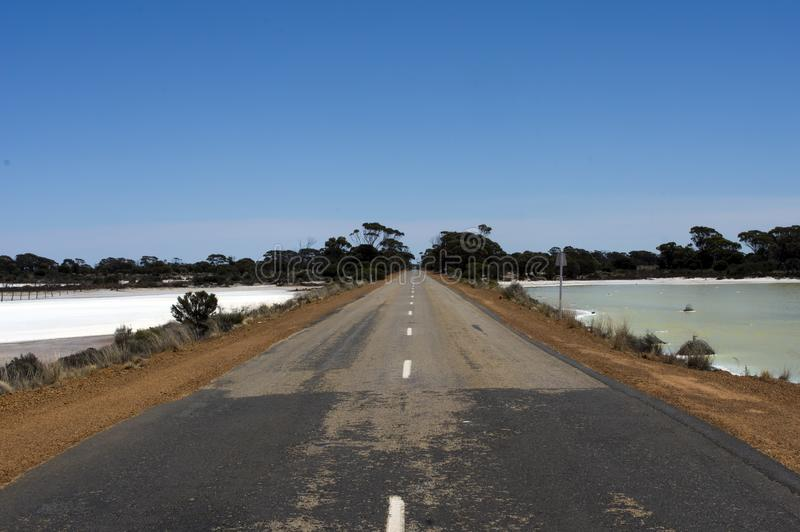 Road through the salt lakes between Hyden and Albany, WA, Australia royalty free stock photography