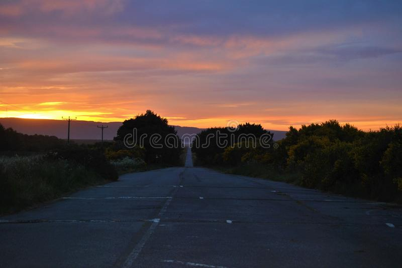 Road scene at sunset royalty free stock photography