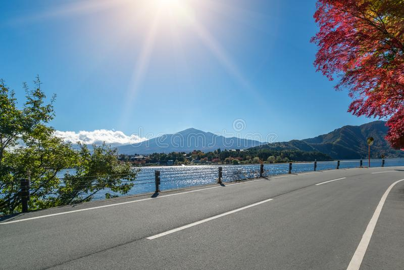 Road Scenery with Lake and Mountain Landscape royalty free stock images
