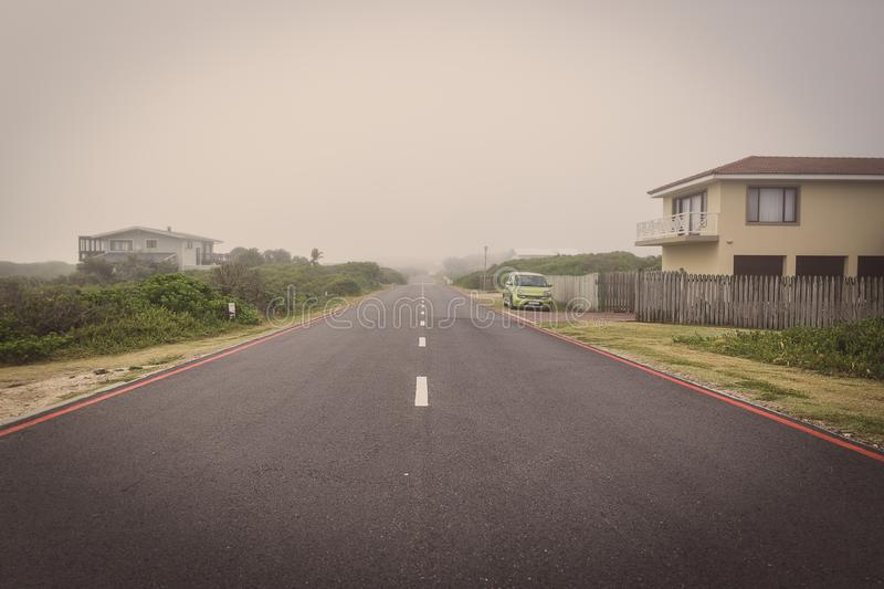 Road in Sedgefiled town on a foggy morning royalty free stock photos