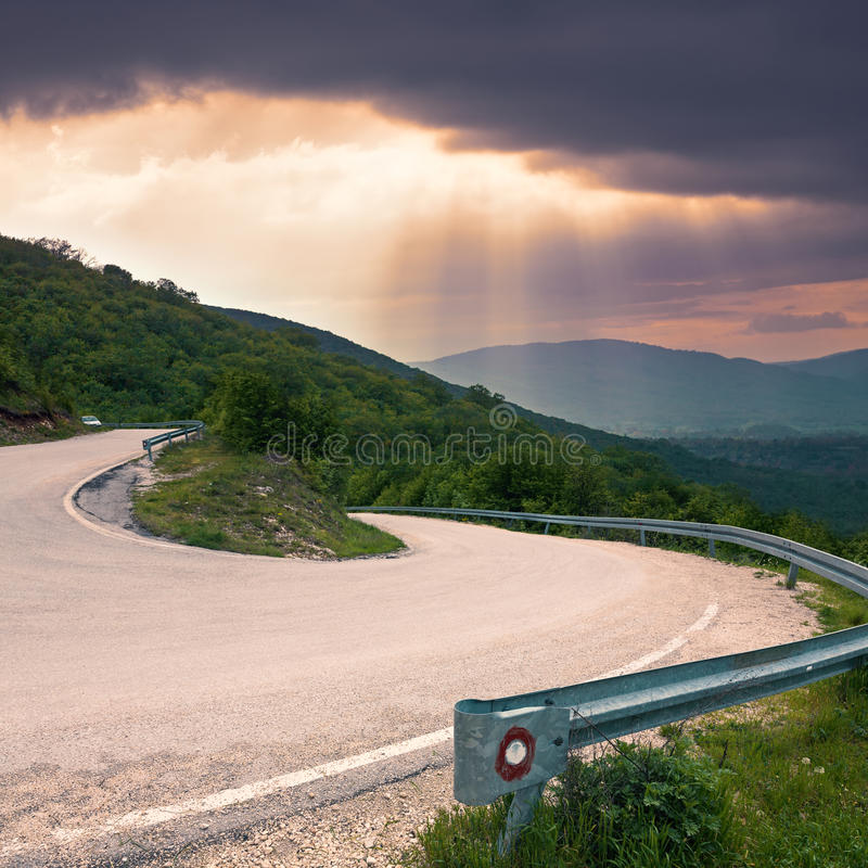Road with a sharp bend in the mountain stock images