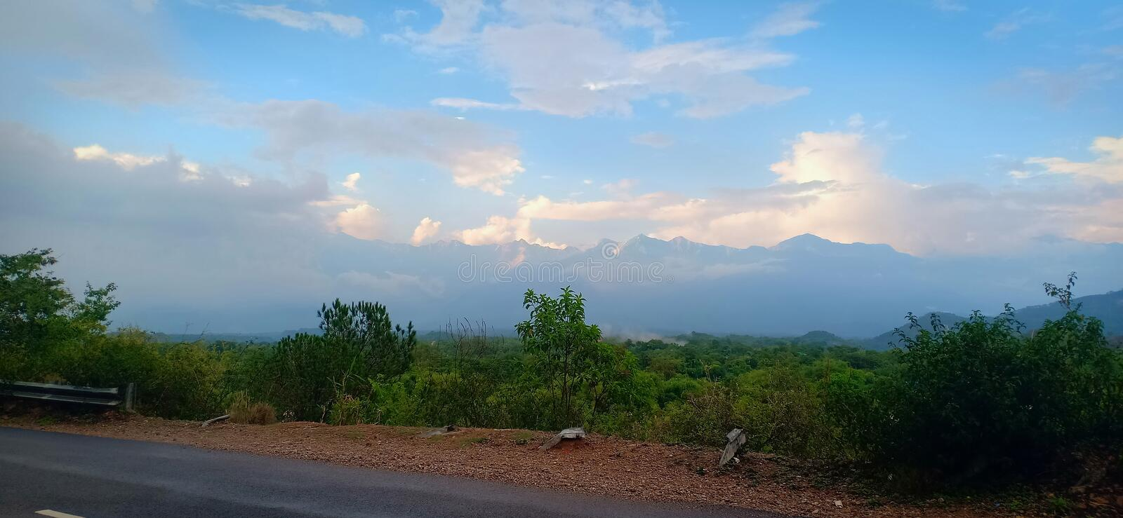 Road side cloudy weather. Palampur Himachal Pradesh royalty free stock photo