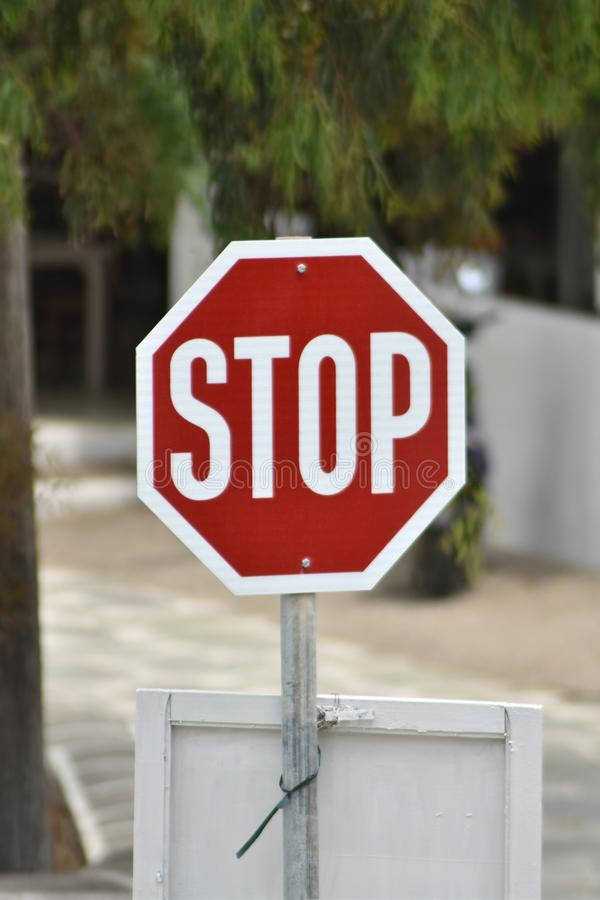 A road side stop sign. A stop sign at a road jinction on the Greek island of Ios stock photo