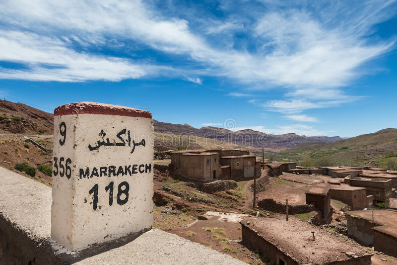 Road Sign along the road between Marrakesh and Ouarzate in the small town of Inkkal, High Atlas, Morocco stock photos