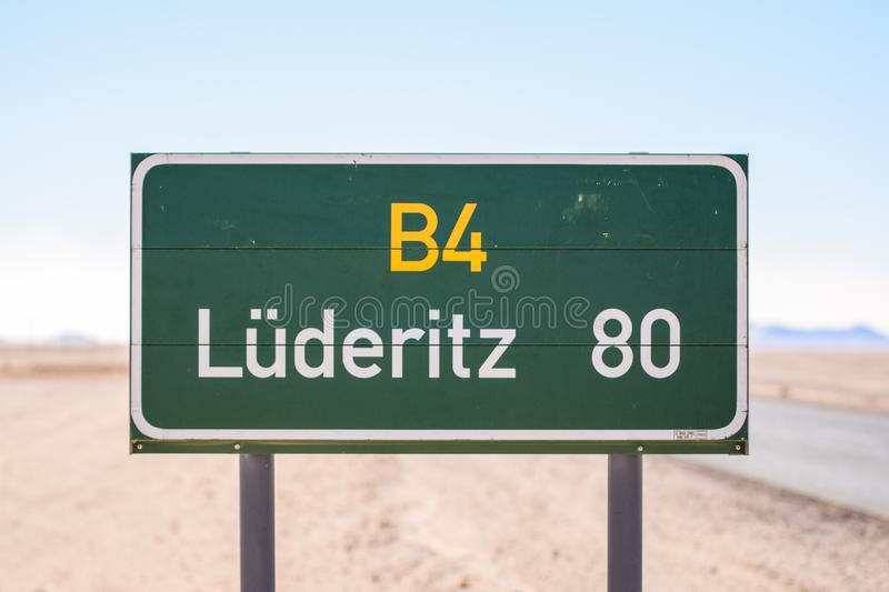 Road sign at the B4 road in Namibia, Africa, leading to the coastal town of Lüderitz / Luderitz with 80 kilometers to go. stock photo
