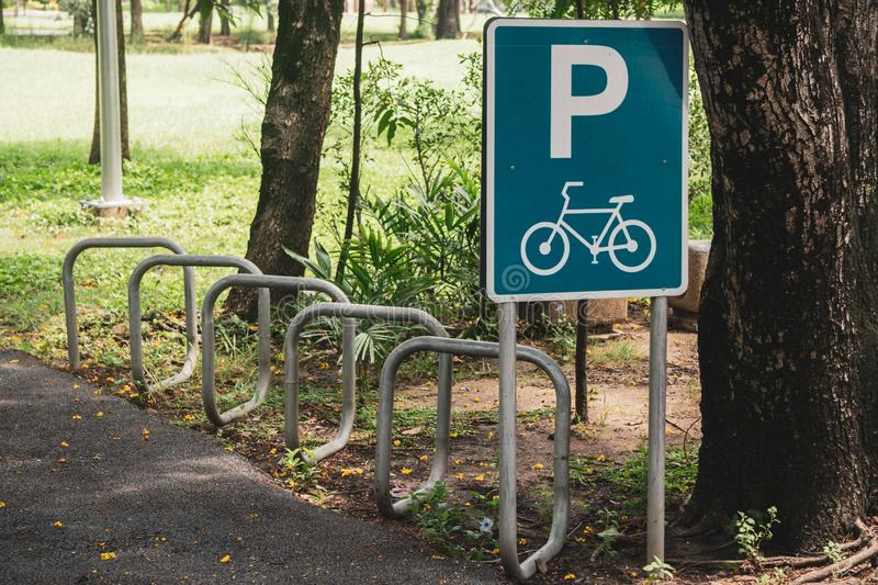 Road Sign, Bicycle parking symbol and bicycle parking rack , Bicycle park area sign in square frame in public park stock images