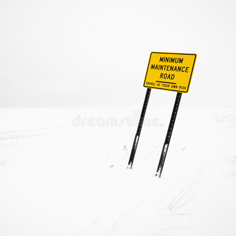 Road sign in blizzard. stock photos