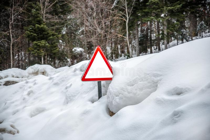 Road sign with a clean place for text is in deep snow royalty free stock image