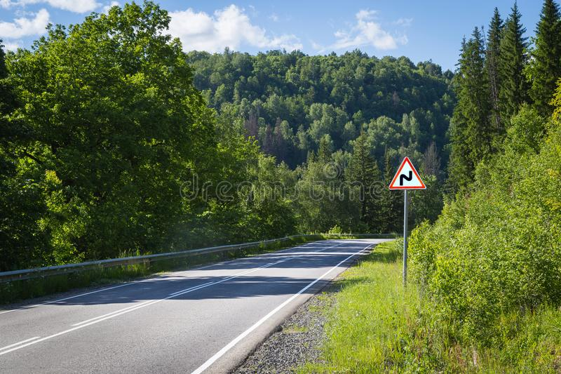 Road sign dangerous turn royalty free stock photography