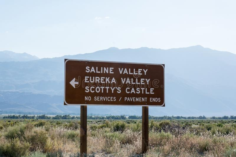 Road sign for Death Valley National Park points of interest - Scotty`s Castle, Eureka Valley and Saline Valley. No services on an stock images