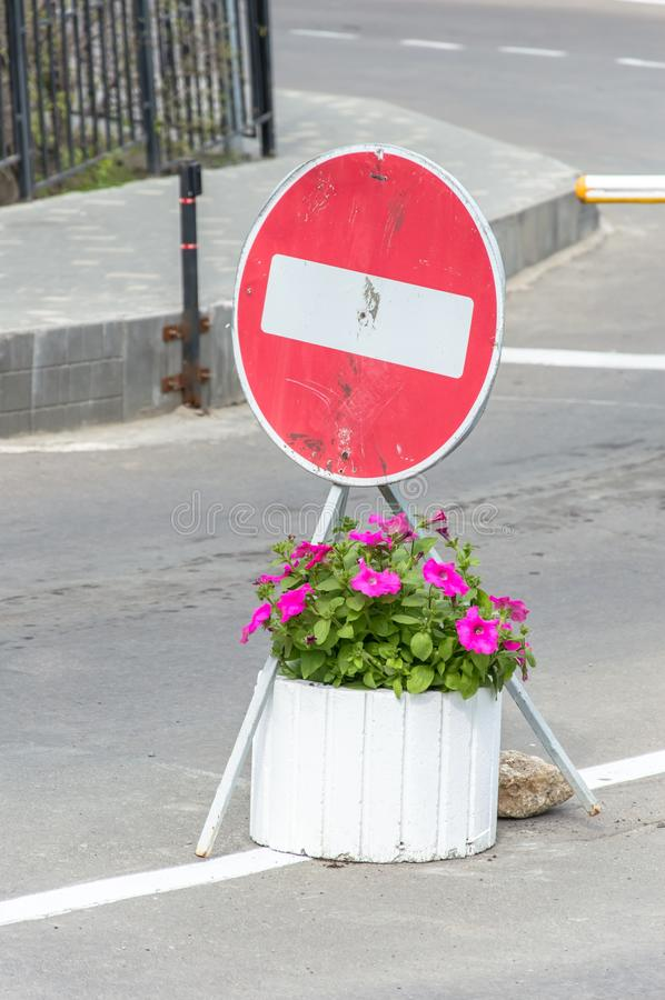 Road sign and flowers under it royalty free stock photo