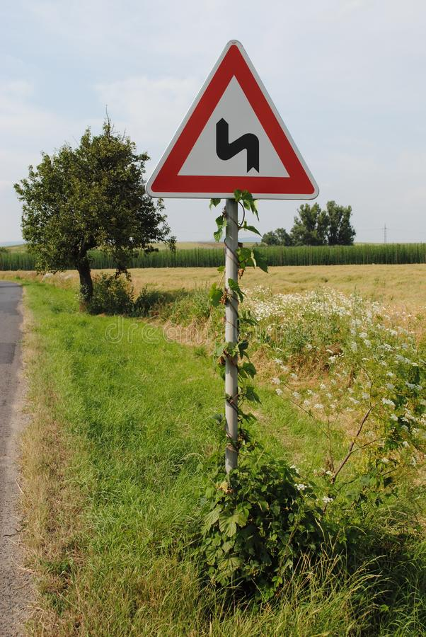 Road sign in green field background royalty free stock photos
