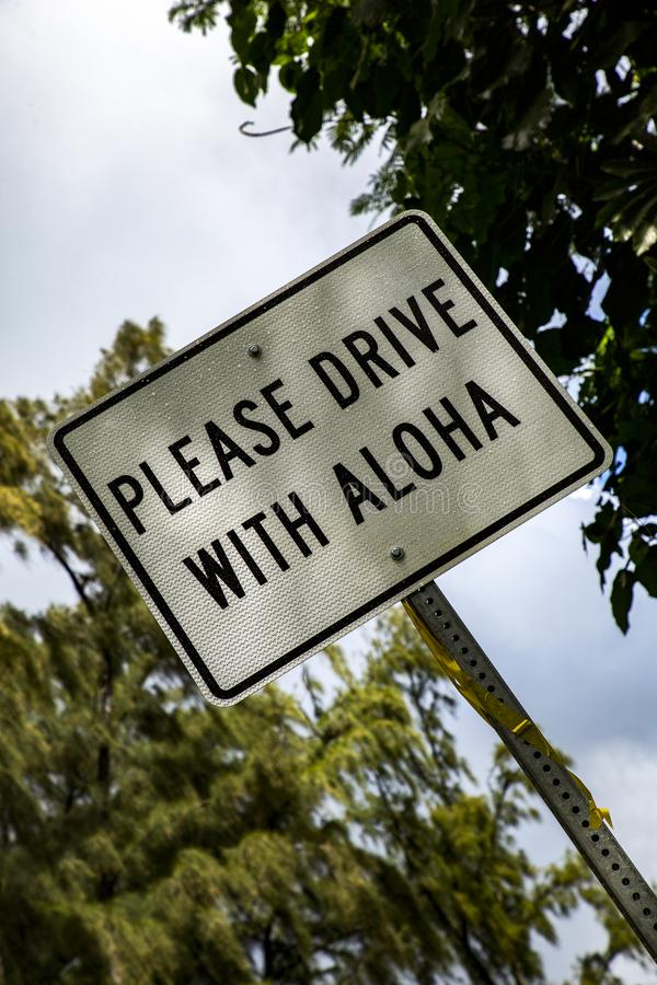 Road sign Hawaii. Aloha as philosophy and life motto on a street sign royalty free stock photography