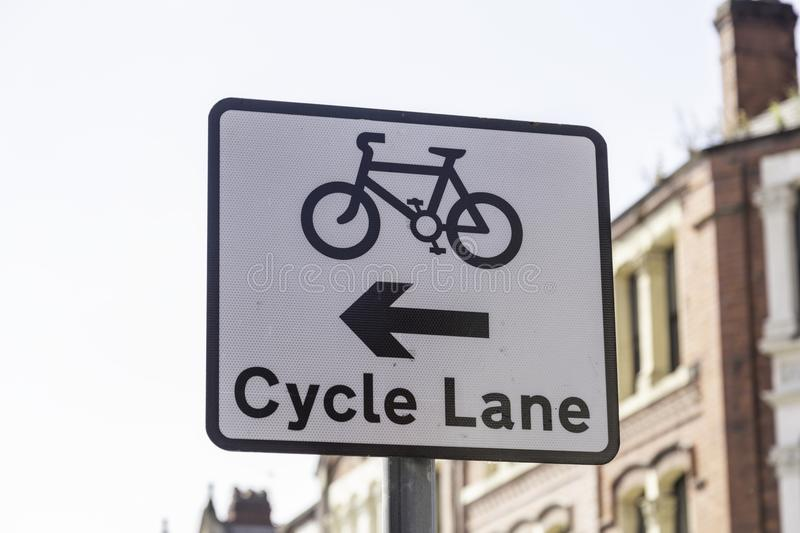 A road sign indicating the availability and position of a cycle royalty free stock photography