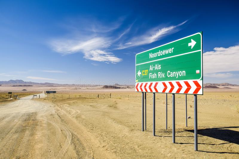Road sign at the intersection between the C37 and D31 roads between the towns Noordoewer, Ai-Ais Fish River Canyon and Aussenkehr. Gravel roads, mountains and stock photography