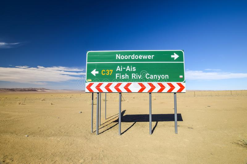 Road sign at the intersection between the C37 and D31 roads between the towns Noordoewer, Ai-Ais Fish River Canyon and Aussenkehr. Gravel roads, mountains and stock image
