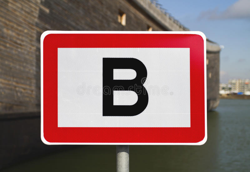 Road sign with letter B stock photo