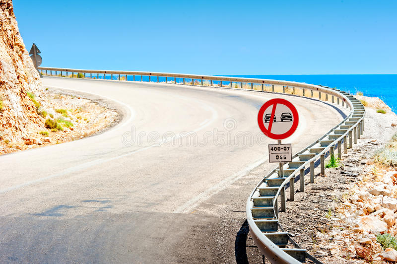 Download Road Sign And A Mountain Road Along Sea Stock Image - Image: 35093993