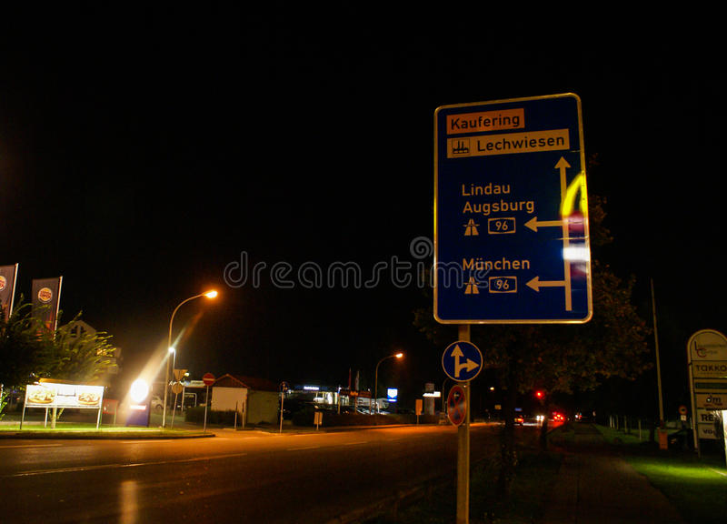 Road sign at night in Germany royalty free stock images