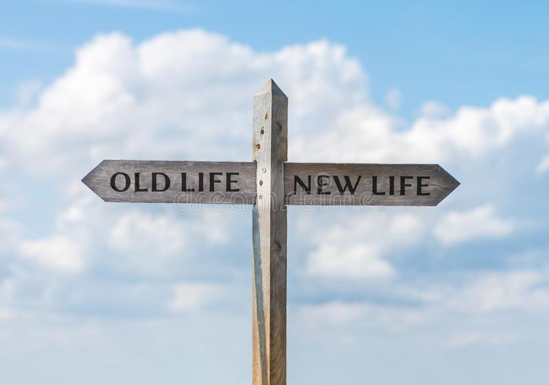 Road sign with old life and new life direction against sky.  stock images