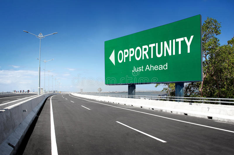 Road with sign of opportunity royalty free stock photos