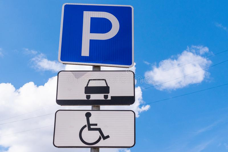 Road sign parking against the blue sky. Parking sign for disabled people. Close-up royalty free stock images