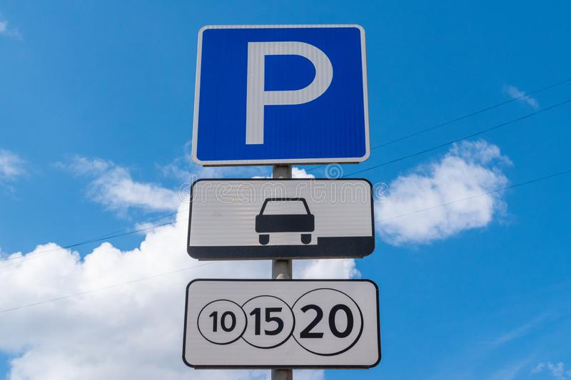 Road sign parking against the blue sky. A sign of a paid parking. Close-up stock photo