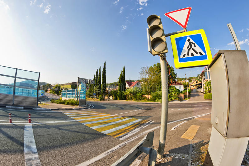 Road sign pedestrian crossing and markings on the road. Road sign at the entrance to the highway warn about the presence of a pedestrian crossing stock photo