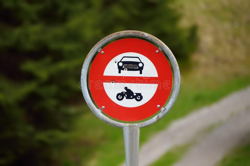 Road sign prohibiting access to cars and motorbikes on walk trail. Road safety royalty free stock photography