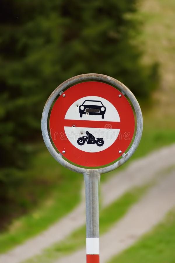 Road sign prohibiting access to cars and motorbikes on walk trail. Road safety stock images