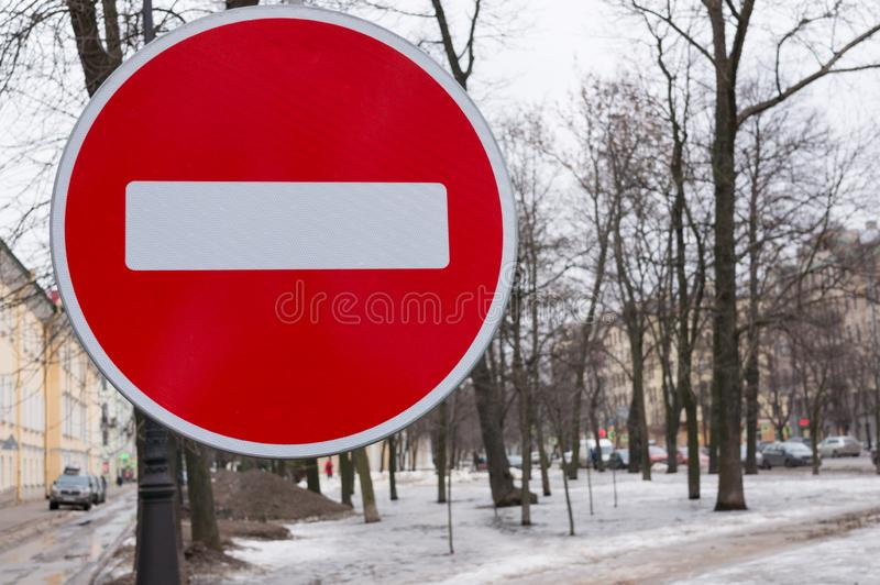 Road sign prohibiting traffic on the background of a winter city stock photo