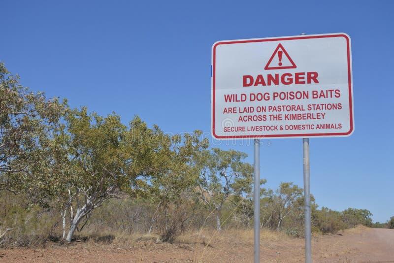 Road sign read:Danger Wild dog poison baits stock photos