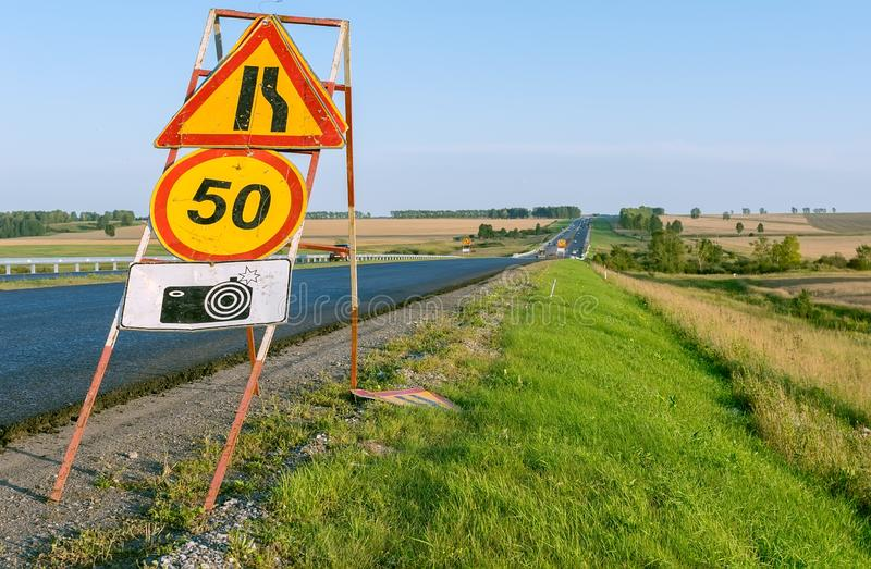 Speed limit road sign on the highway stock image