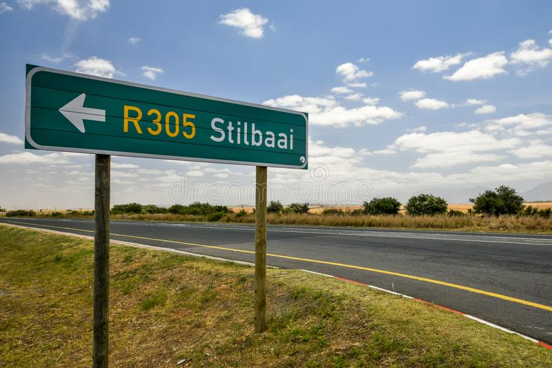 Road sign at the route N2 road in South Africa near Still Bay pointing to Still Bay R305. stock images
