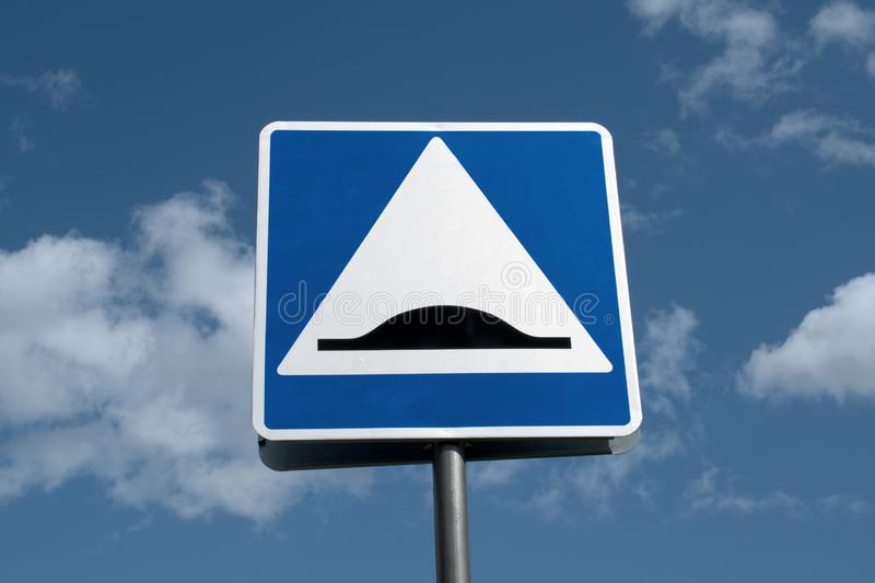 Road sign speed bump on cloud sky background.  royalty free stock photos