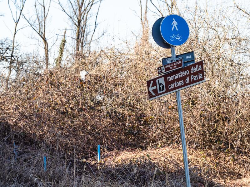 Road sign to medieval monastery Certosa di Pavia royalty free stock photo