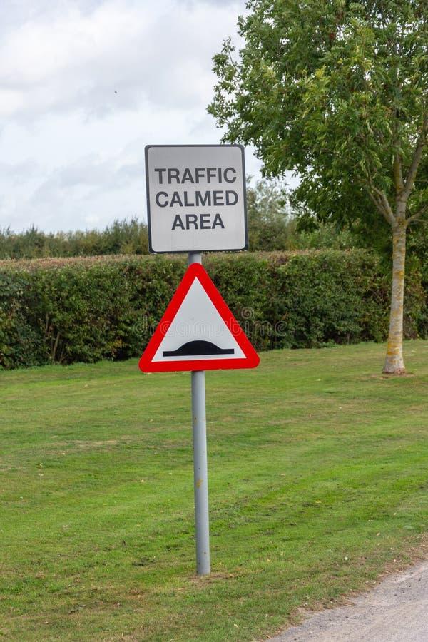 Speed bump warning road sign stock image