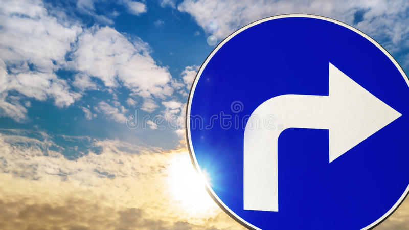 Road sign turn right. Against the sky stock photo