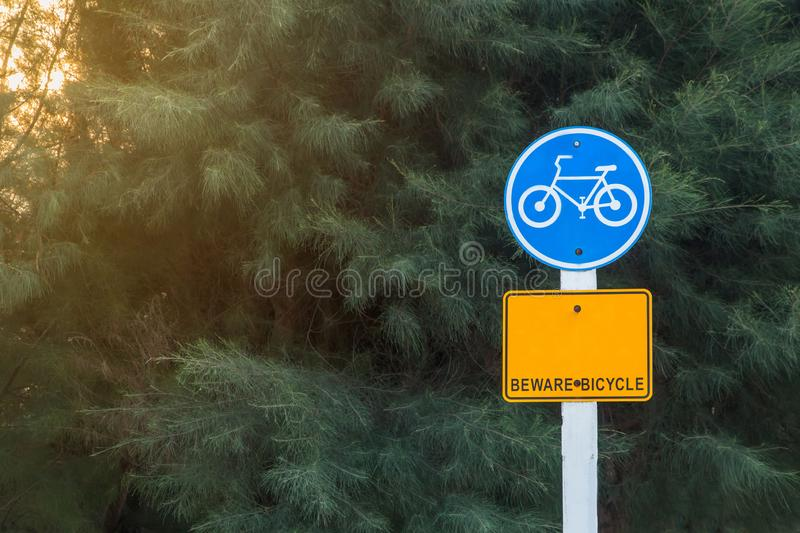 Road sign for used Bicycles on side road,Designation of the bike trail in the forest. Journey, traffic, transportation, symbol, outdoor, background, street stock photo