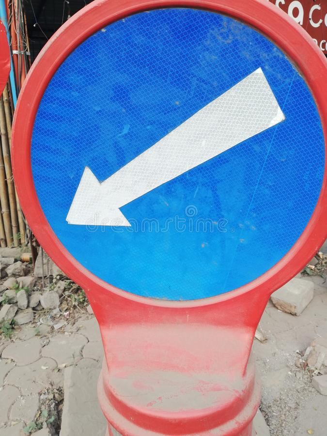 Road signboard indore India arrow pointing downward royalty free stock images