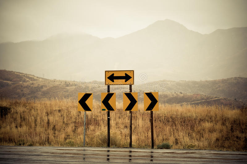 Road signs. At the end of the road pointing left and right royalty free stock photos