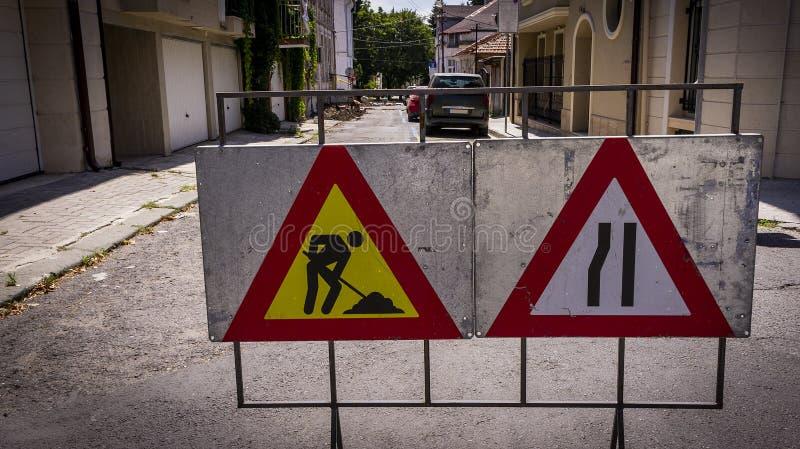 Road signs indicating road repair. Repair of urban road infrastructure stock image