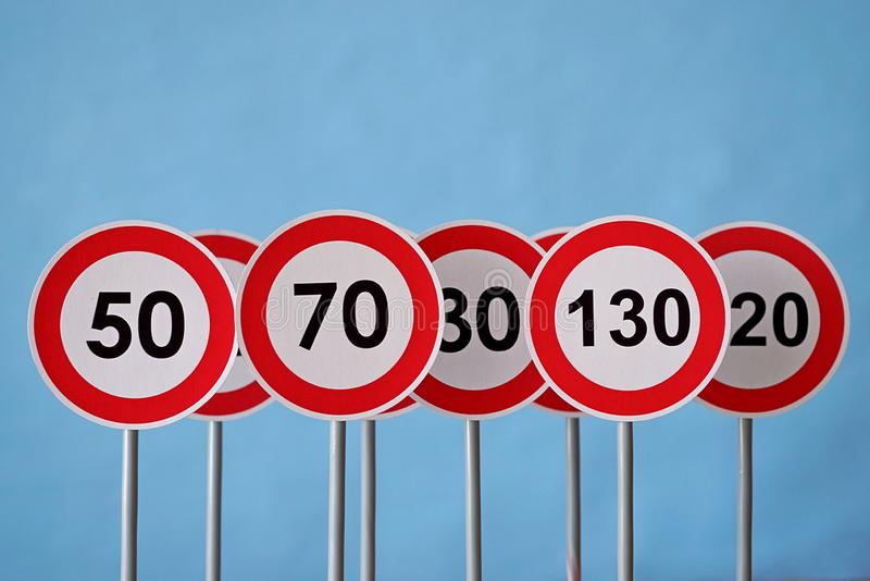A road signs indicating a speed limit. Traffic signs on a blue background stock images