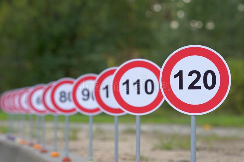 A road signs indicating from 110 to 120 as the speed limit royalty free stock photo