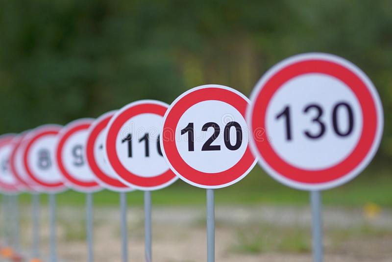 A road signs indicating from 120 to 130 as the speed limit stock photo
