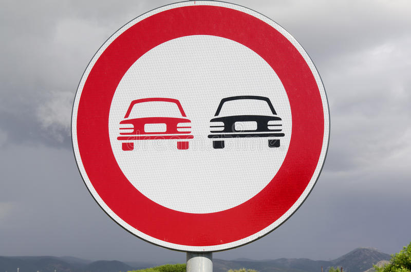 No overtaking. Road sign. Vertical traffic signal installed at the beginning of a stretch of road where overtaking between vehicles is forbidden because it is royalty free stock photos
