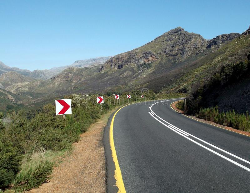 Road signs in pass. Road curve indicated by road signs in the Du Toitskloof pass, Western Cape, South Africa on the Worcester side royalty free stock photo