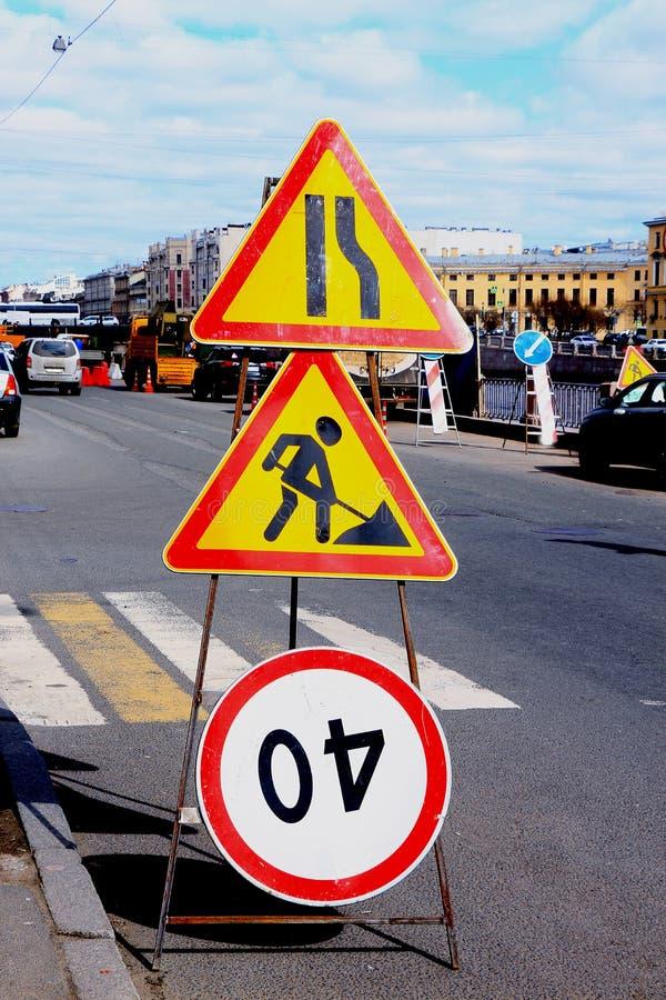 Road signs of repair work stock photos