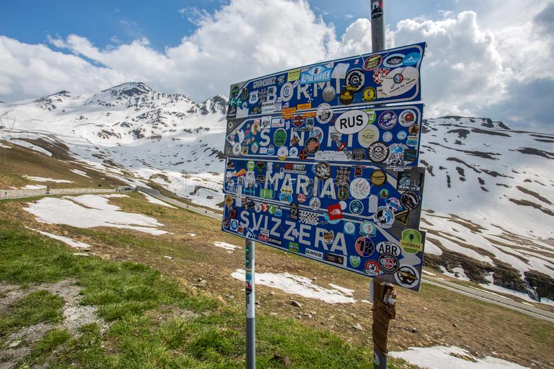 Road signs at Stelvio Pass, the highest automobile pass in Italy, 2758 metres, located. Between Trentino-Alto Adige and Lombardy, Italy stock image